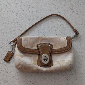 Beautiful wristlet clutch bag by Coach 🍀